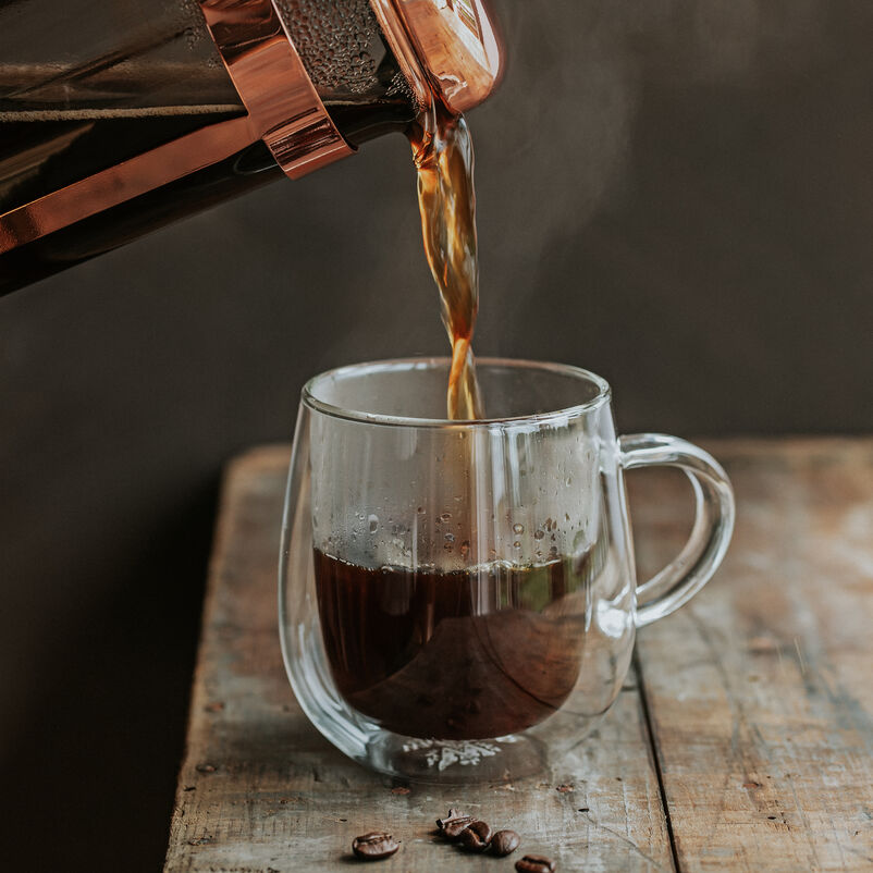 Coffee poured from a cafetiere into a mug