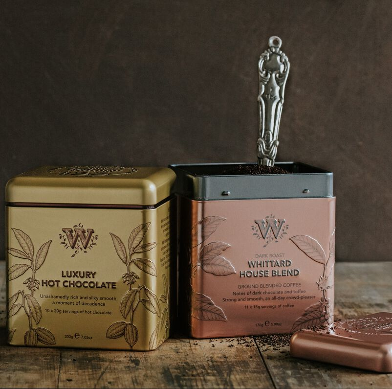 135 year Luxury Hot Chocolate and House Blend tins