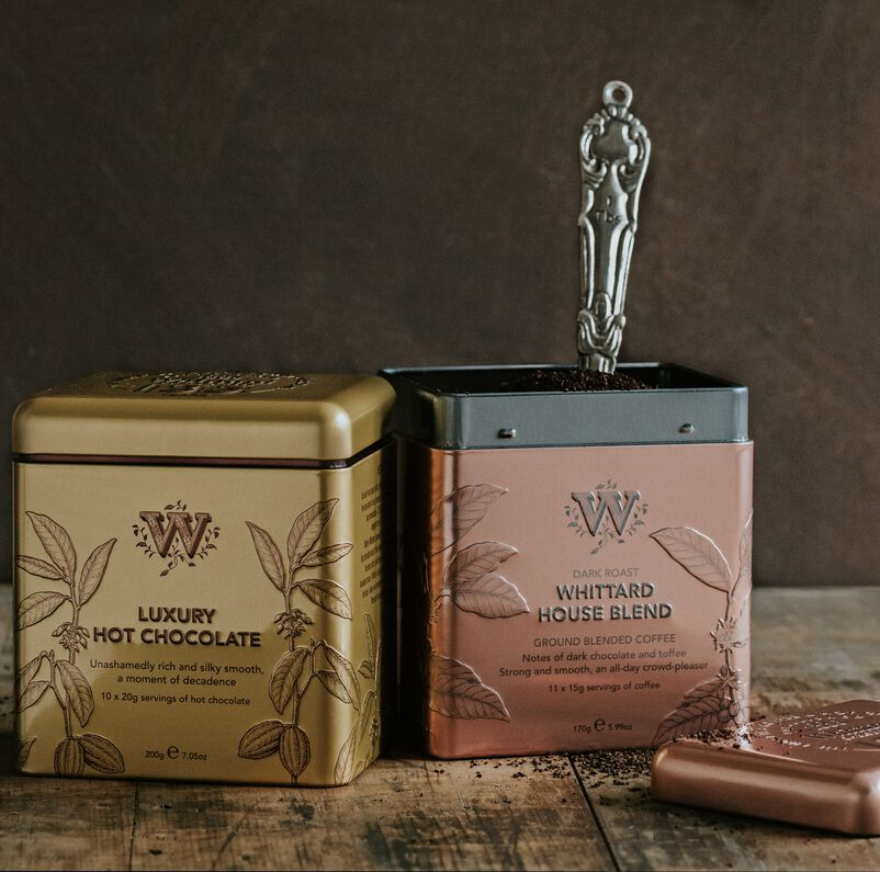 135 year hot chocolate and coffee tins