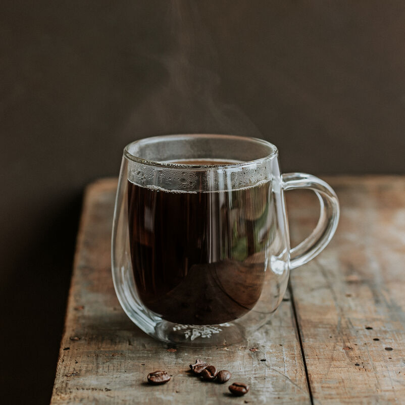 Nova Mug with coffee on a table