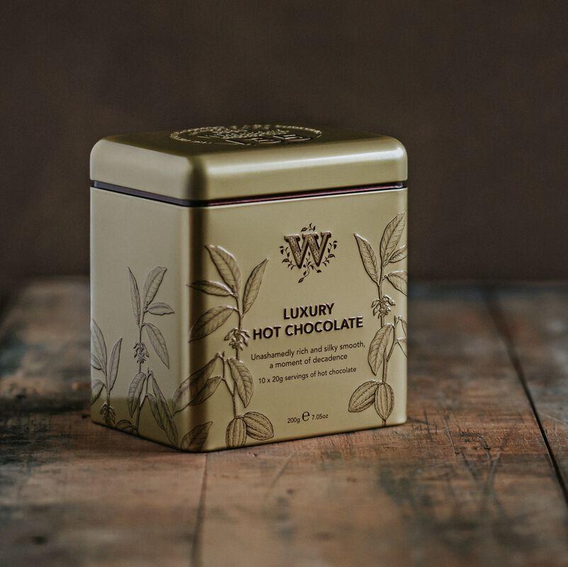 135 year Luxury Hot Chocolate tin on table
