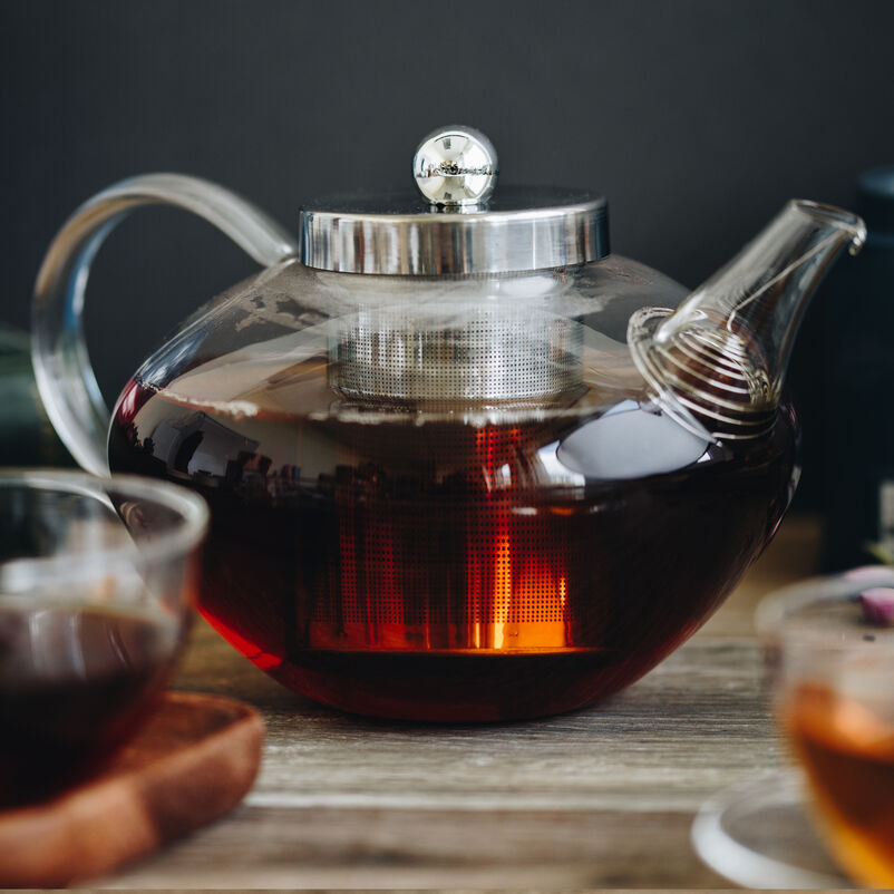 Chelsea Glass Teapot with tea brewing on a table