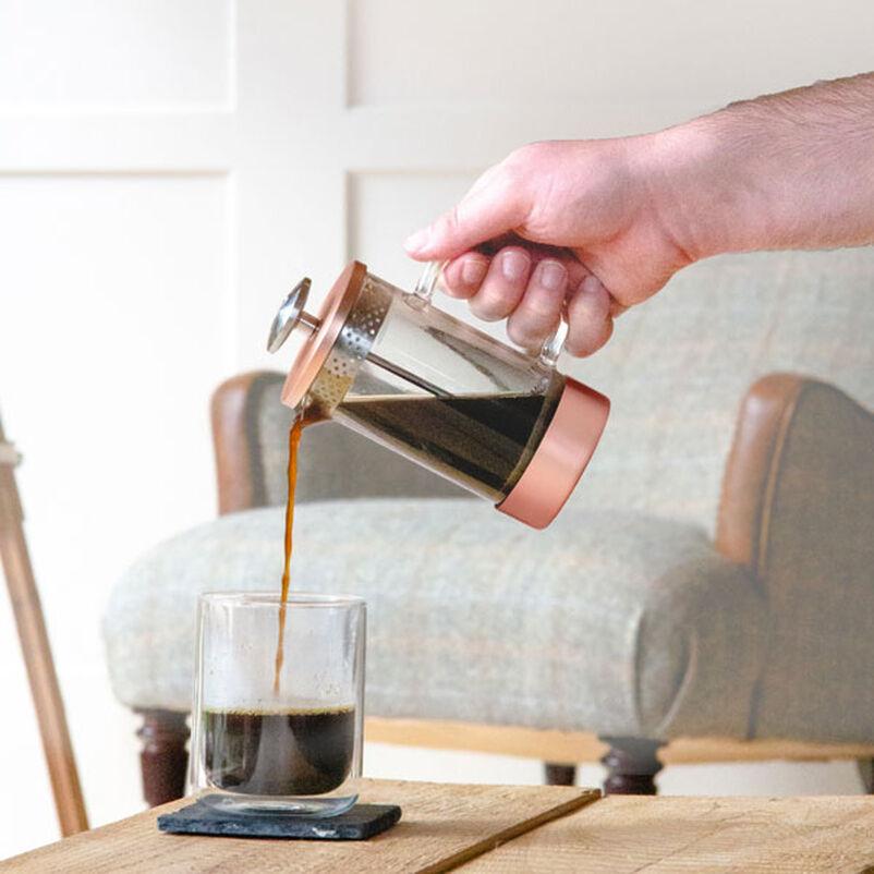 Barista & Co Copper Coffee Press pouring coffee