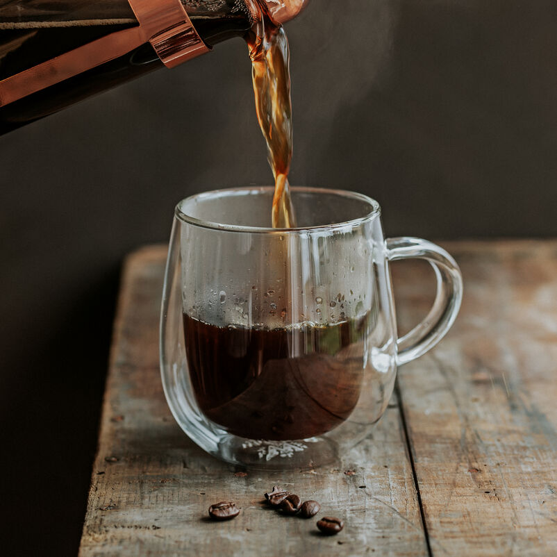 Nova Double-Walled Mug with coffee being poured